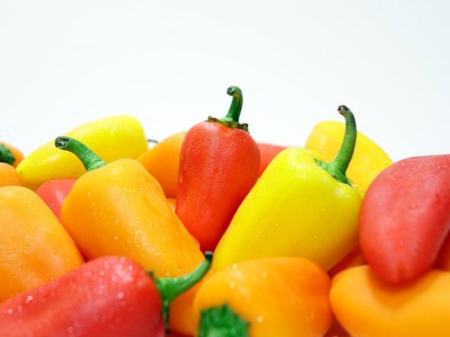 Peppers; the fruit of the herbaceous plant with the same name
